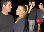 Simon Cowell cannot keeps his eyes, or hands, off dinner date Carmen Electra