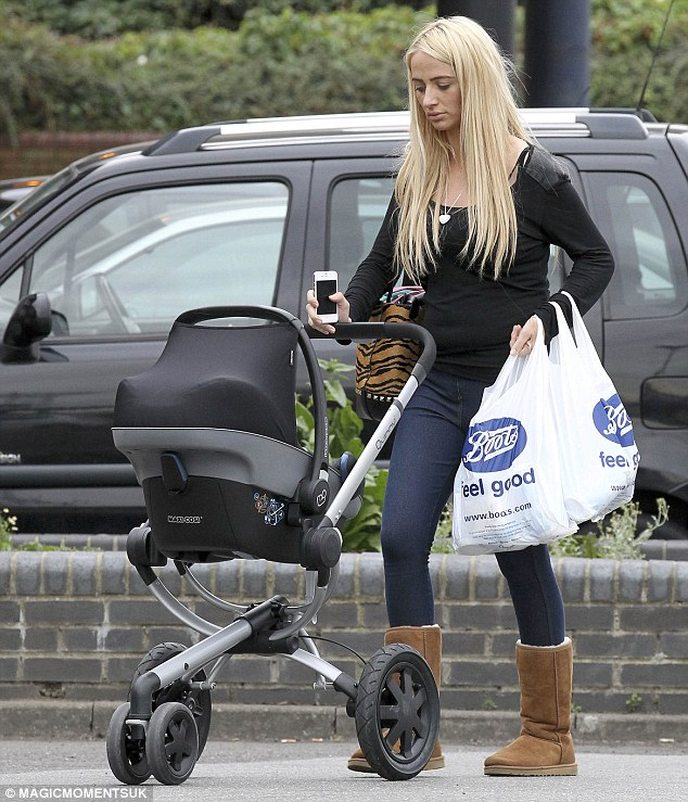 Life as a single mother: Chantelle Houghton was pictured in Essex on Thursday shopping with her baby Dolly