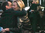 Where's the pout gone? Kate Moss in joyous mood as she grabs her driver in a warm embrace