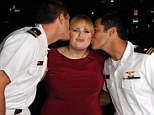 Hello sailor! Rebel Wilson grinned as she received a kiss on each cheek from a pair of handsome sailors at the Hollywood premiere of Pitch Perfect on Monday night