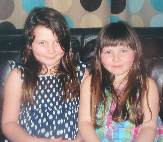 Loss: Five-year-old Grace Mackay (right), pictured with her sister Callie, was rescued from the water but died in hospital