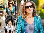 Actress Sarah Jessica Parker keeps herself busy this morning and takes her twins, Tabitha and Marion to school with the help of her nanny