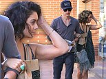 Mirror, mirror on the wall ... Vanessa Hudgens checks her look in a shop window as she strolls with beau Austin Butler