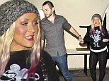 Curvy Christina Aguilera dresses for comfort in her favourite leggings on date night with boyfriend