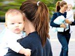 Devoted mom: Jennifer Garner holds her baby son, Samuel, close during grocery shopping trip to Gelson's in L.A.'s Pacific Palisades on September 22