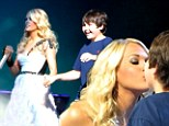 Carrie Underwood kissing a fan at a concert in Louisville, Kentucky