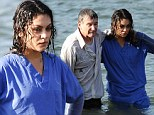 Wet, but not so wild: Miserable Mila Kunis gets soaked to the skin in a New York river as she films scenes for new Robin Williams movie