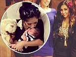 Snooki gives her son Lorenzo a kiss and shows off her post-baby figure