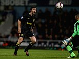 At the double: Mauro Boselli scored twice to fire Wigan through at Upton Park