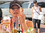 Eyes bigger than her belly: Jaime Pressly indulges in a post work-out glass of wine... but can't finish her lunch