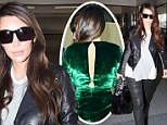 No room for a mishap here! Kim Kardashian keeps covered up following her emerald dress wardrobe malfunction