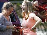 Honey Boo Boo's sisters Anna 'Chickadee' and Jessica 'Chubbs' share a giggle over the Good Book