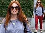Back home in New York after her Emmy win, Julianne Moore steps out in a pair of tomato-red trousers