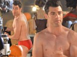 Schmidt's back! Max Greenfield strips to a VERY small pair of red trunks as he shoots scenes for New Girl