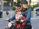 Cool mum: Edie Falco and her daughter Macy took to the streets on Tribeca in New York City for a spin on their scooter