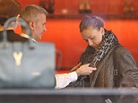Wild thing: The 27-year-old actress was seen trying on a series of pricey leopard print scarves