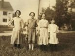 Through the ages: Right, Mary Deschene, admitted to being 11 and said she helped her sister spool all summer at the mill. Next her is Lumina Demarais, 12. Rosina Coyette, second from left, said she was 14 but Mr. Hine said he doubted it