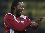 Lord of the dance: Chris Gayle celebrates dismissal of England's Jos Buttler