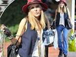 Boho chic: Brooke Mueller pairs a tomboyish vest with jeans and red hat on trip to Fred Segal