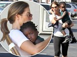 Me and my girl: Jillian Michaels showers adopted daughter Lukensia with cuddles as they make a lunch stop in Malibu