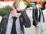Dazed Macaulay Culkin wanders around with paint-spattered jeans before taking a cab Home... Alone