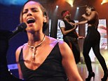Empire State of a behind: Alicia Keys shows off her enviable derriere as she takes to the stage in tiny crop top and skin tight trousers