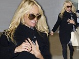 Who needs Dancing with the Stars? Reject Pamela Anderson flashes a smile as she catches a flight out of New York