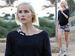 Get dressed in the dark?: A coltish Isabel Lucas dons a clashing ensemble for her favourite hike