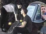 Dancing in the dark: Rooney Mara shows off her moves on the bonnet of Ryan Gosling's car during a night shoot for their new film