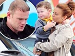 Wholesome family fun: The Rooneys treat son Kai to meal at children's playhouse... but Wayne appears to be a little bored