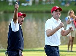 Get in: Phil Mickelson (left) celebrates with Keegan Bradley after a fourballs victory