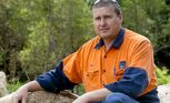 Toowoomba worker Jamie Farmer was one of three men who saved an elderly woman after her car crashed into a dam.