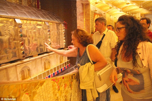 Wanting answers: Many pilgrims visit Pio's tomb for his prayers and healing powers
