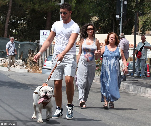 Moving on: Fico enjoyed a stroll with her family and their dog