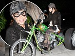 Wild thing! Aerosmith frontman Steven Tyler rolls up to a sushi meal on his outrageous three-wheeler motorcycle