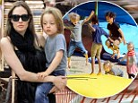 Jumping for joy! Angelina Jolie takes her delighted children to play in the park during their stay in France