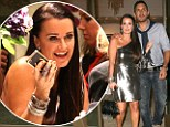 Hands off, he's mine!: Kyle Richards keeps her husband close and her friends closer at a glitzy party in her new boutique