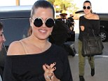 Travelling in style: Khloe Kardashian jets off to Miami toting a giant designer handbag