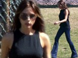 It's all in the jeans! Victoria Beckham looks slim and leggy in flared denim as she cheers on son Cruz in soccer match