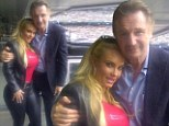 The odd couple! Curvy Coco Austin and acclaimed actor Liam Neeson pal up at a Jets game