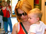 Never too early to put your best foot forward! January Jones takes little Xander shoe shopping