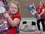 Living doll! Honey Boo Boo sports silver heels as she leaves Walmart with a giant Bratz toy