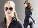And she even stuns in her gym clothes! Rosie Huntington-Whiteley shows off her toned physique in all black