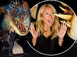 Don't get lost in there! Petite Kelly Ripa sticks her head into a dragon's mouth as she catches DreamWorks show on tour
