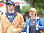Day off: Chelsea Clinton and her husband Marc Mezvinsky took a romantic stroll in Madison Saquare Park with their dog Soren Saturday morning