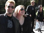Avril Lavigne and her fiance Chad Kroeger (singer of the band Nickelback) strolling in Paris