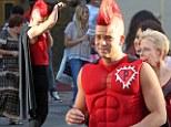 Mark Salling dresses as a superhero on the set of Glee