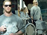 After shopping at upmarket boutique Zadig & Voltaire with his wife and their newborn baby daughter India Rose, Chris Hemsworth was seen pounding the streets in west London.