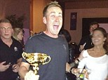 Thirsty work: Ian Poulter enjoys a drink as he celebrates with the Ryder Cup
