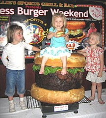 Three fans of the largest hamburger commercially available